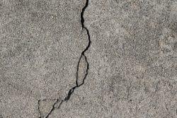 Concrete cracks with loose edges
