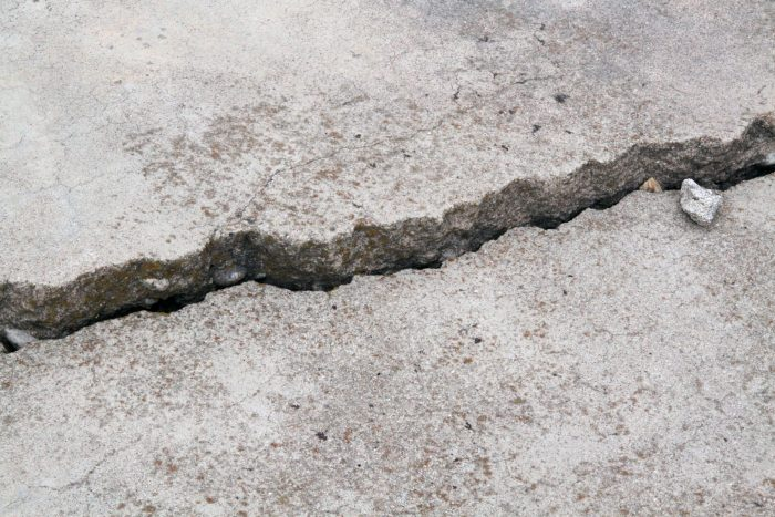 Concrete crack with one side higher than the other side