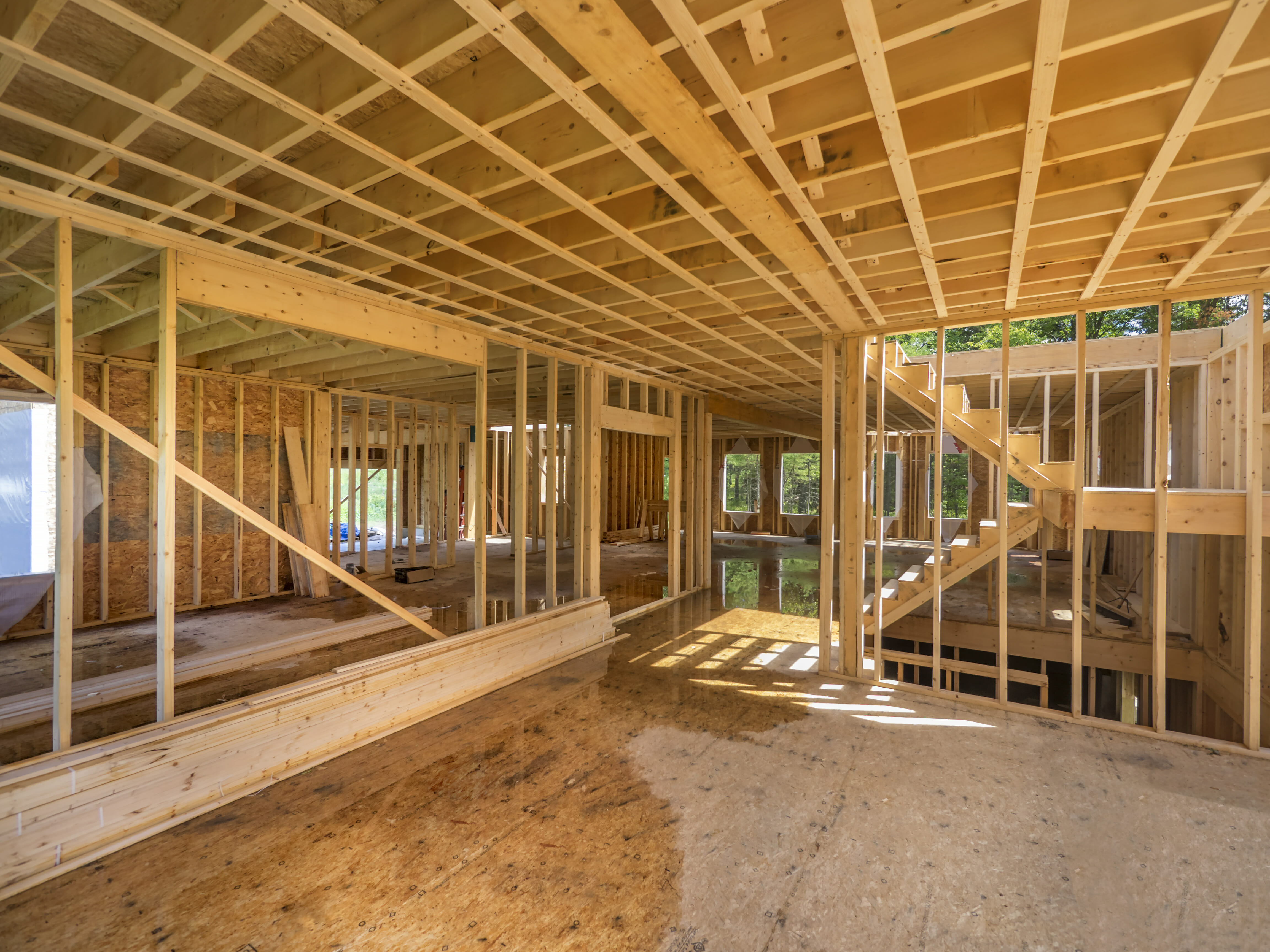 A house in the framing process with sloping floor