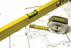 A Level with plans and a measuring tape