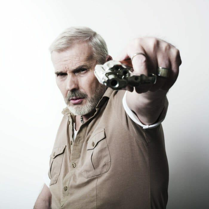 Inspector holding gun