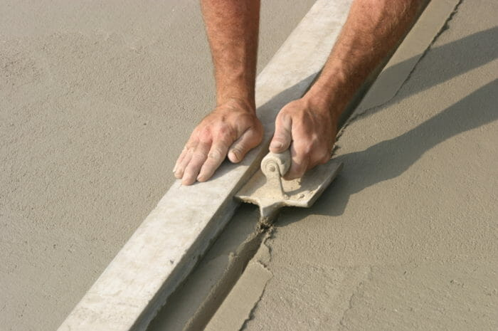 Concrete finisher with hand jointer