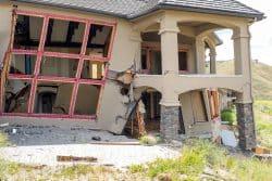 Earthquakes and slope creep