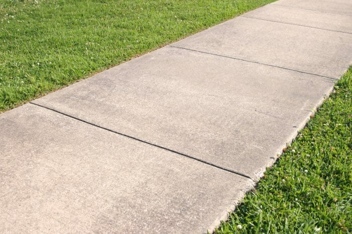 Concrete sidewalk with control joints