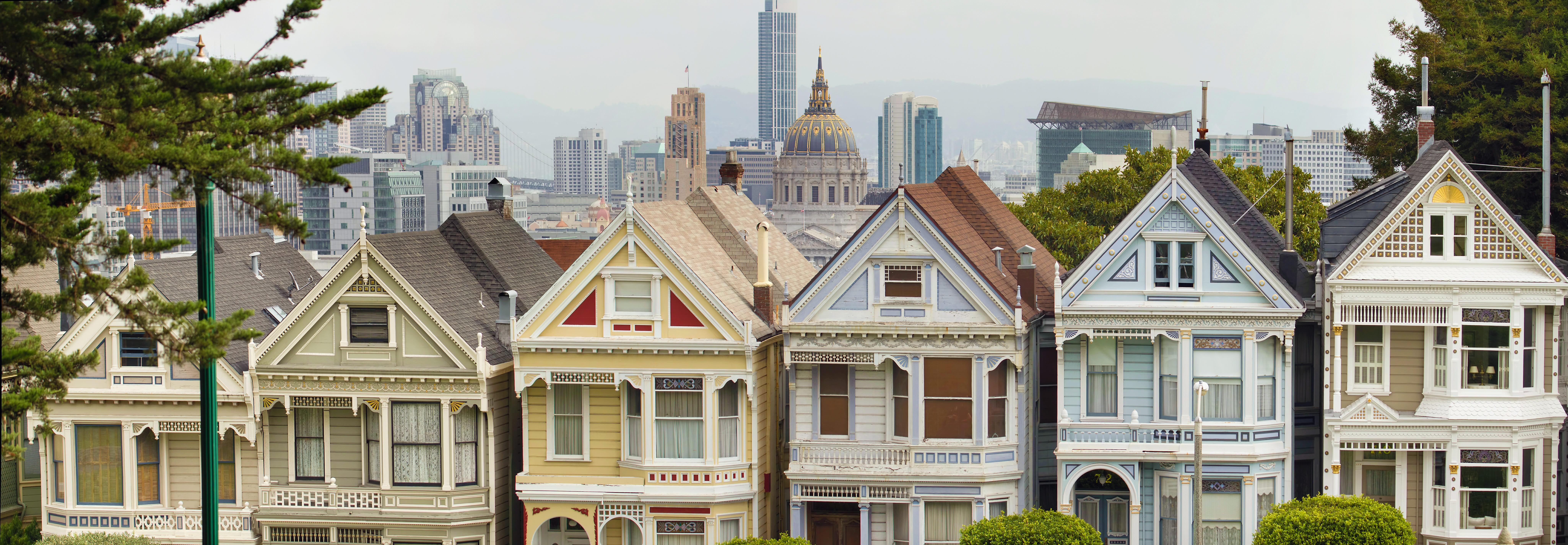 Painted Ladies Row Houses by Alamo Square with San Francisco Skyline Panorama