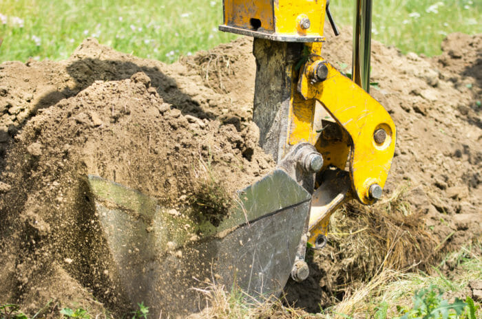 Backhoe bucket digging