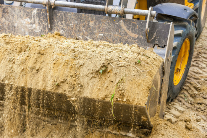 Soil in tractor bucket