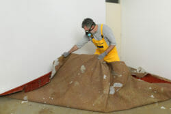 Removing carpet with mold.
