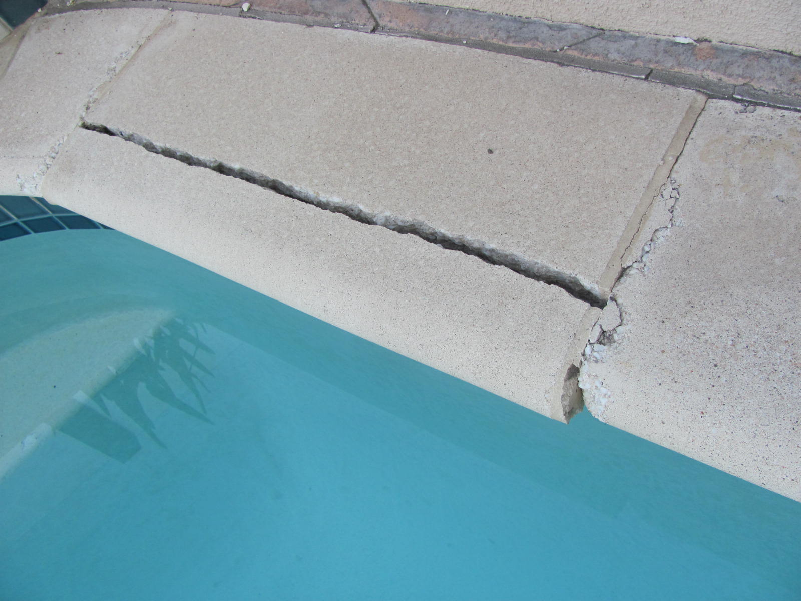 Tile Stained Around The Pool Calcium And Mineral Build