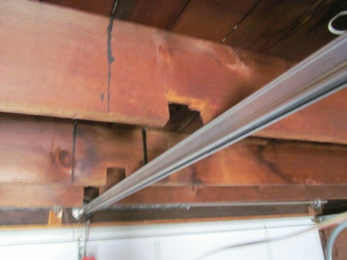 Owners May Have Notched The Ceiling Joist Or Rafters In Garage Order To Install A Door Track Run Electrical Wiring Plumbing