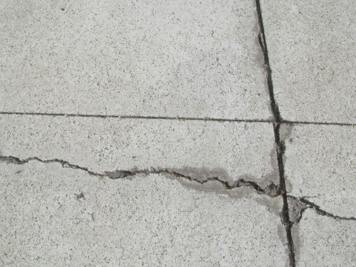 Crack in concrete by control joint