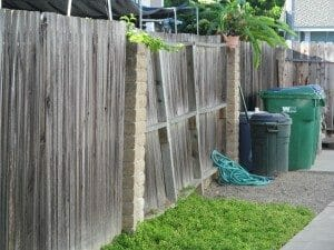 Leaning wood fence