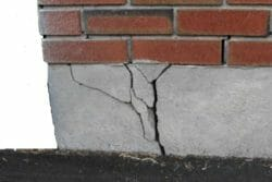 Badly cracked concrete foundation