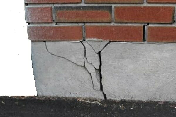 Badly cracked concrete foundation