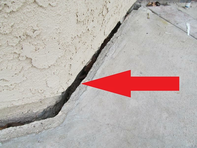 Slope creep evidenced by patio slab pulled away from foundation