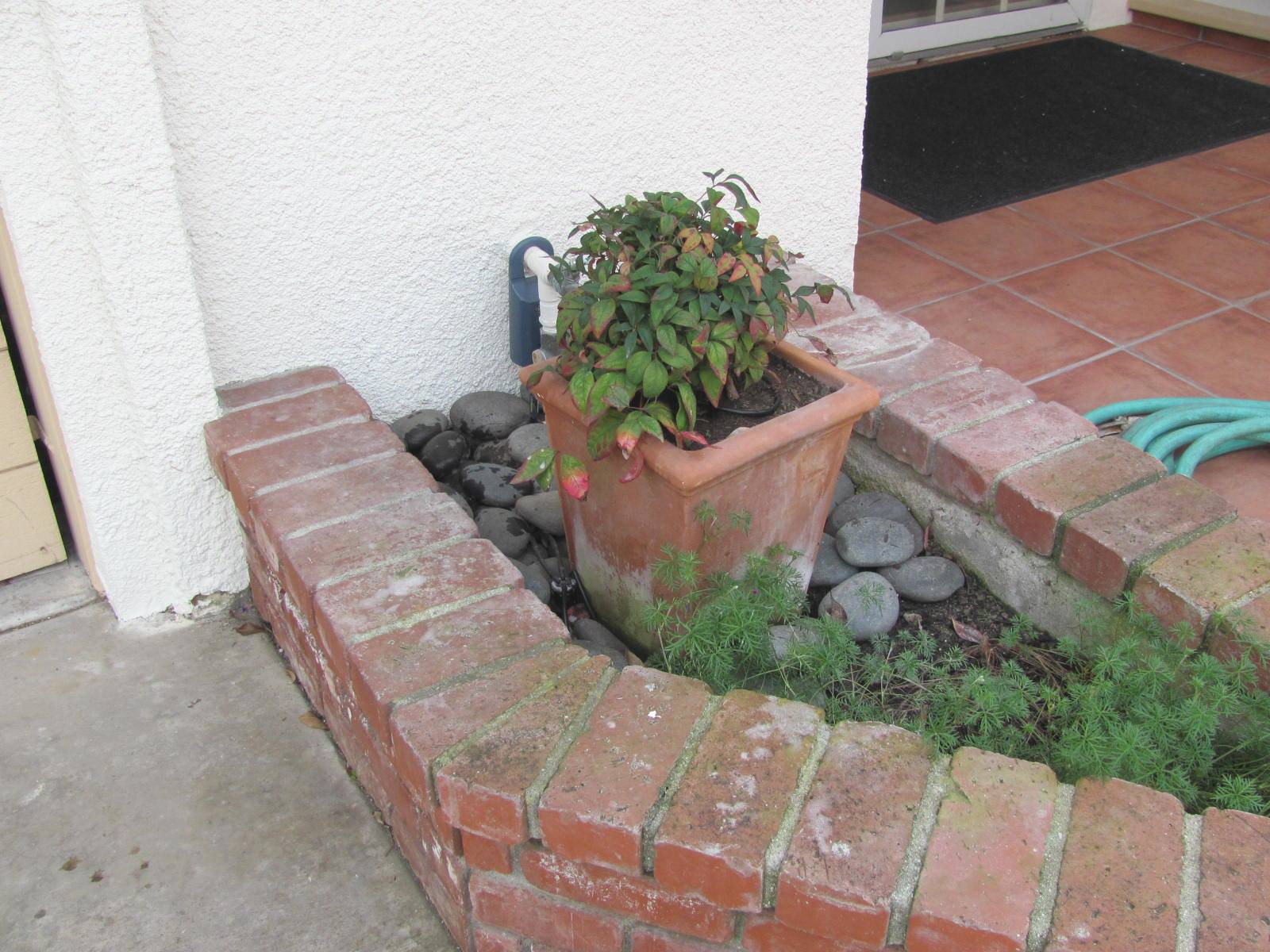 Planter against a homes wall or siding
