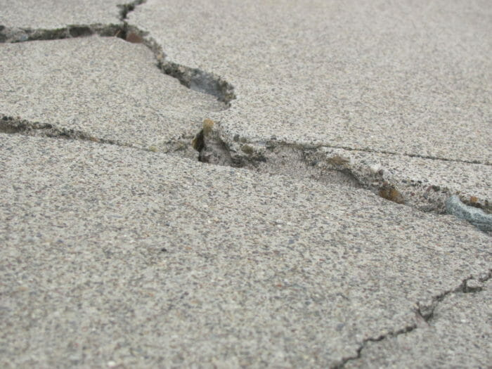 Concrete cracked and badly damaged with no repar in it