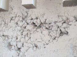 Rock pockets in concrete is where the rock, called aggregate, is exposed and is usually caused by failure to vibrate the concrete properly when pouring it.