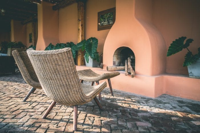 Paver patio, wicker chairs, fireplace