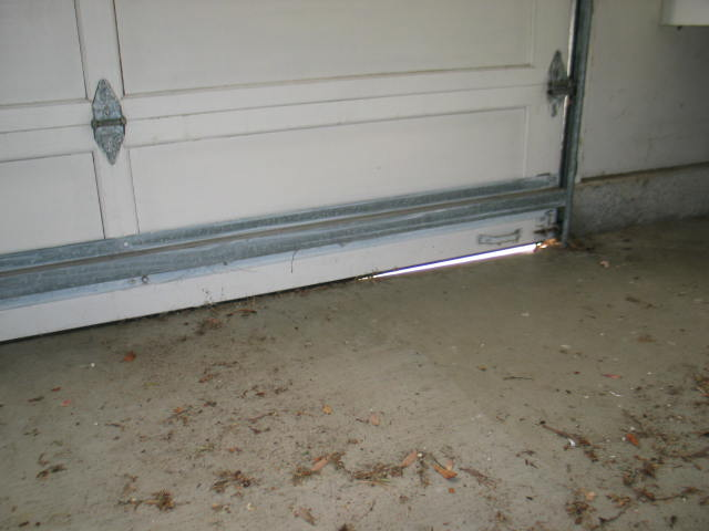 Gaps at bottom of garage door indicates that slab has for Garage verdun gap