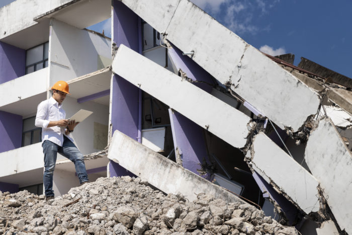 Engineer evaluating building collapse