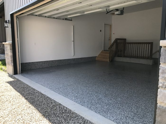 View of two car garage with epoxy coating on the floor